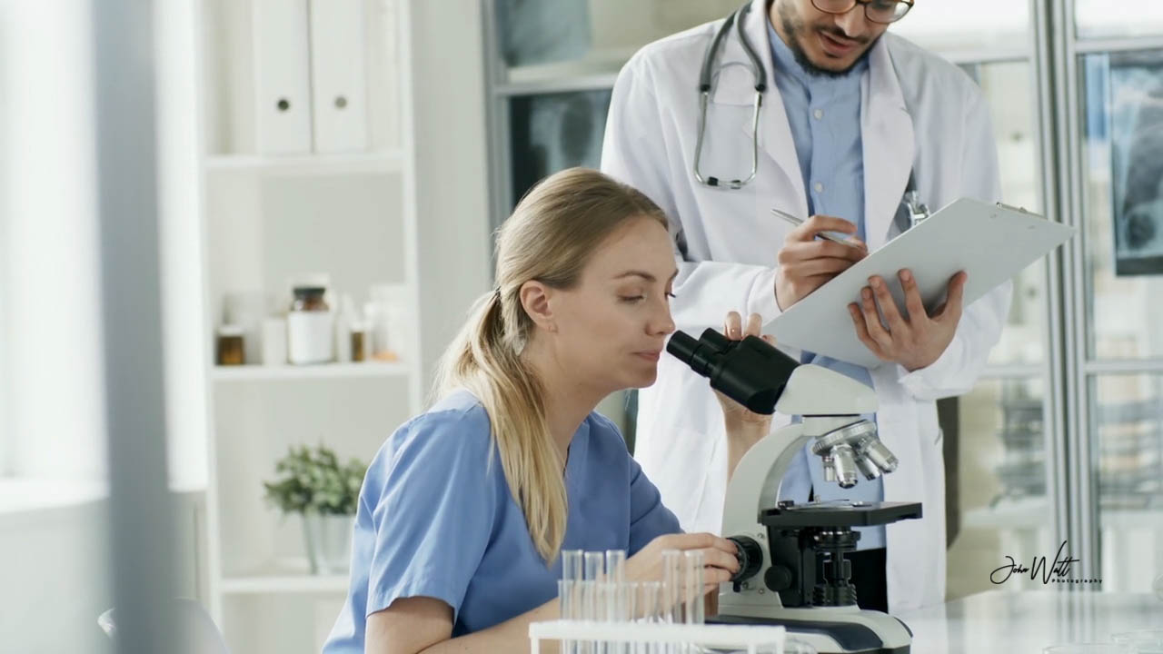 Doctor looking through a microscope